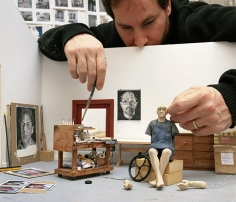 Sculptor with model of Chuck Close in his summer studio, Norwalk, CT, 2005