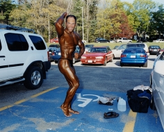 Man applying tanning lotion before a bodybuilding competition, Worcester, MA, 2003