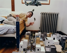 Boy in his bedroom with model of Kandahar, Afghanistan, Watertown, MA, 2001