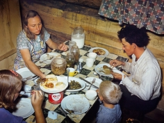 Debbie Grossman, The Fae and Doris Caudill family eating dinner in their dugout, 2009/10
