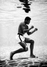 "Flip Schulke. Muhammad Ali ""training"" underwater.  1960 / printed 1990s."