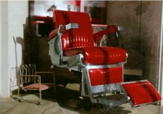 William Eggleston. UNTITLED (RED BARBER CHAIR). 1974.