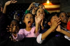 Scout Tufankjian. Shaniece Sprattling, 8, Ilona Cooper, 5, Imani Cooper, 10, Indya Cooper, 8, and Ciera McNeil, 10 (L-R) cheer as Barack Obama speaks at a rally in Dillon, SC on January 23, 2008.