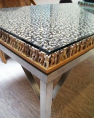 Table, 2000 PVS figures on phenolic board, glass plate, stainless steel table frame