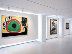 Installation view of Selected Works by 20th Century Masters featuring three paintings on the same wall of the main gallery space. From left to right, Joan Miró, Oiseaux en Fête pour le lever du Jour, 21 Mars 1968, 1968 Oil on canvas 130 x 195 cm. (51 1/8 x 76 3/8 in.), Pablo Picasso, Mousquetaire aux Oiseaux II, 13 January 1972, 1972 Oil on canvas 146 x 114 cm. (57 1/2 x 44 7/8 in.), Fernand Léger, Objets dans l'espace, 1931 Oil on canvas 73 x 92 cm. (28 3/4 x 36 1/4 in.). Photography by Bianca Boragi. ©Helly Nahmad Gallery NY.