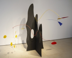 """Alexander Calder, Crag with Petals and Yellow Cascade,1974.  This sculpture is part of Calder Stabile series which is known as revolutionary gesture in the sculpture history as its getting rid of the pedestal. """"Crag with Petals and Yellow Cascade"""" features two undulating metal stems balanced in the cavities and peaks of this mountainous form, disrupting the dense and static plinth and allowing light polychromatic elements to swirl and catch the air. """