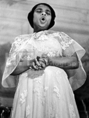 Alfred Eisenstaedt, Marian Anderson, the great contralto, in a rare performance of spirituals at the Academy of Music, Philadelphia, Pennsylvania, 1938