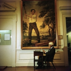Slim Aarons, American poet and biographer of Abraham Lincoln, Carl Sandburg, beneath the 'rail-splatter' portrait of the president of Chicago Historical Society Museum