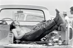 John Dominis, Steve McQueen sleeping in the back of his pick up truck, California, 1963