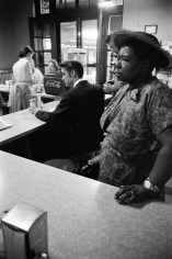 Alfred Wertheimer, Segregated Lunch Counter: Elvis Presley waits for his bacon and eggs at the railroad station lunch counter while a black woman waits for her sandwich, Chattanooga, Tennessee, 1956