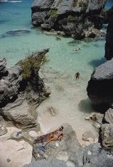 Slim Aarons, On The Beach In Bermuda, 1967: Sunbathing and swimming at a beach in Bermuda