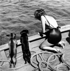 Toni Frissell, Woman with Two Dachshunds, circa 1940