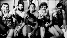 George Kalinsky, The Knicks at the NBA Championships: Jerry Lucas, Walt Frazier, Willis Reed, Phil Jackson, and Bill Bradley seated in locker room, Los Angeles, 1973