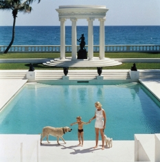 Slim Aarons, Mrs. F C Winston Guest (aka Cee Zee Guest) and her son Alexander Michael Douglas Dudley Guest in front of their Grecian temple pool in Villa Artemis, Palm Beach, 1955