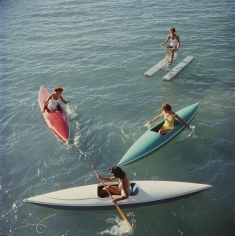 Slim Aarons, Lake Tahoe Trip, 1959: Young women canoeing on the Nevada side of Lake Tahoe
