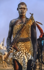 Carol Beckwith and Angela Fisher, Dinka Warrior with Leopard Skin and Kalashnikov Rifle, South Sudan, 2006