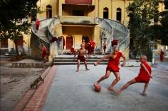 Steve McCurry, Monks Play Football, Burma, 2010