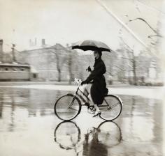 Tom Palumbo, Anne St. Marie on a Bike with Umbrella, circa 1956