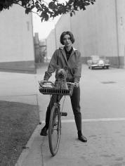 Sid Avery, Audrey Hepburn on her bike at Paramount Studios, 1957