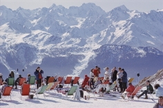 Slim Aarons, Lounging In Verbier: Holidaymakers in sun loungers on the slopes at Verbier, Switzerland, February 1964
