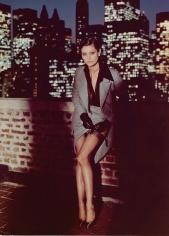 Helmut Newton, Untitled (Model lifting skirt on balcony)