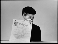 Louise Dahl-Wolfe, Model with Menu for Maxim's, 1951