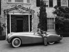Sid Avery, Humphrey Bogart, Lauren Bacall and their son, Stephen, in their Jaguar XK 120 at home in Los Angeles, 1952