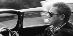 Sid Avery, Steve McQueen driving his 1957 XK-SS Jaguar through Nichols Canyon in Hollywood, 1960