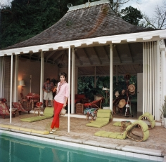 Slim Aarons, Family Snapper, 1959: Babe Paley by the pool. Her husband, William Paley, is snapping the photographer at their cottage in Round Hill, Jamaica