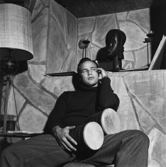 Sid Avery, Marlon Brando with Bongo Drums  at his Beverly Hills Home, 1955