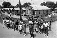 Harry Benson, Meredith March Onlookers outside their homes, Canton, Mississippi, 1966