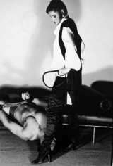 Chris von Wangenheim,  Untitled (Model standing over man with whip)