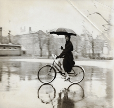 Tom Palumbo, Anne St. Marie on Bike with Umbrella, circa 1956