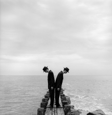 Rodney Smith, Twins Leaning outward on dock no. 1, Sherwood Island, Connecticut, 1997