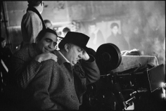 Mary Ellen Mark,  Guiseppe Rotunno with Federico Fellini who pretends to sleep on the set of Fellini's Satyricon, Rome, Italy 1969