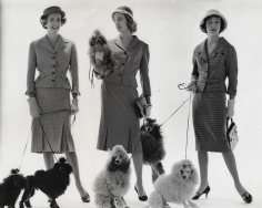 Norman Parkinson, Newest Suits Off the Couture Page (Models with Dogs), suits by John Cavanagh, Worth, and Hardy Amies, VOGUE, 1958