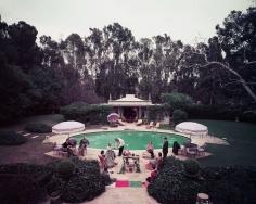 Slim Aarons, Scone Madame?, circa 1960: Guests gather around pool at home of interior decorator James Pendleton