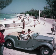 Slim Aarons, Katharine Hepburn, 1953: Driving along the waterfront with Irene Mayer Selznik at Montego Bay, Jamaica