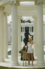 Slim Aarons, C.Z. Guest, 1955: The American socialite with a Great Dane at her ocean-front estate, Villa Artemis, in Palm Beach