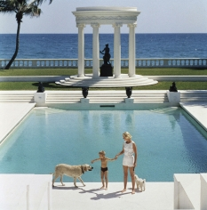 Slim Aarons, The Good Life, 1955: C.Z. Guest and her son Alexander and dog at the pool at their home Villa Artemis in Palm Beach