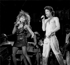 Ron Galella, Tina Turner and Mick Jagger during Live Aid Concert, JFK Stadium, Philadelphia, 1985