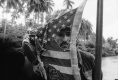 Mary Ellen Mark, Dennis Hopper plays with an American flag, Apocalypse Now, Pagsanjan, Philippines, 1976