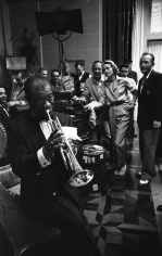 """Bob Willoughby, Grace Kelly, Bing Crosby, and crew are treated to an impromptu concert by Louis Armstrong on the MGM set of """"High Society"""", 1956"""