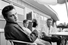 Alfred Wertheimer, Pepsi in Hand: Elvis Presley sitting on the porch of his home at 1034 Audobon Drive, Memphis, Tennessee, July 4, 1956