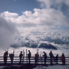 Slim Aarons, Verbier View: Skiers admire the view across a valley of clouds at Verbier, 1964
