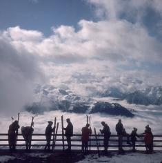 Slim Aarons, Verbier View: Skiers admire the view across a valley of clouds at Verbier, 1964