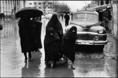 Inge Morath, Veiled women and girls struggling through heavy rain, Tehran, Iran, 1956