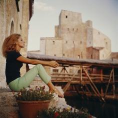Slim Aarons, Dolores Guinnes, 1965: Catching the sun's last rays in Costa Smerelda, Sardinia