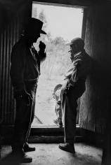 "Phil Stern, John Wayne and John Ford on the set of ""The Alamo"""