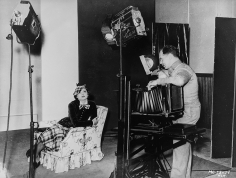 Virgil Apger, Clarence Sinclair Bull photographing Myrna Loy, 1934
